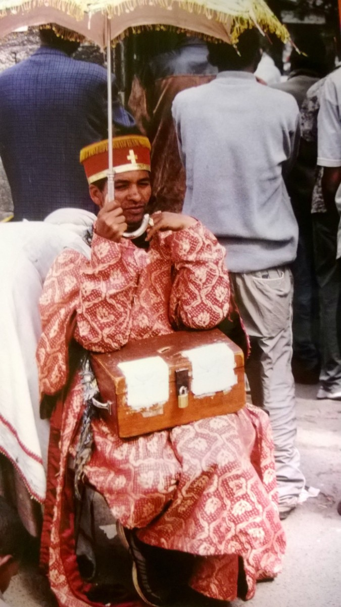 Kněz a kasička na dary; Addis Abeba